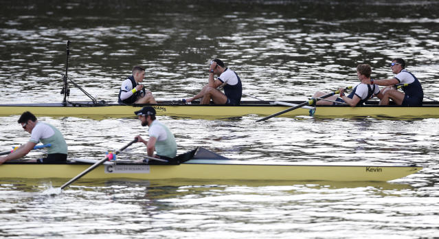 Britain Rowing - 2017 Oxford v Cambridge University Boat Race - River Thames, London - 2/4/17 Oxford and Cambridge crews react at the end of the race Action Images via Reuters / Paul Childs Livepic