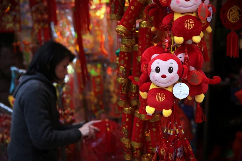 A toy monkey for sale in the markets of the Wan Chai district in Hong Kong, as the Lunar New Year of the Monkey swings into action (AFP Photo/Isaac Lawrence)