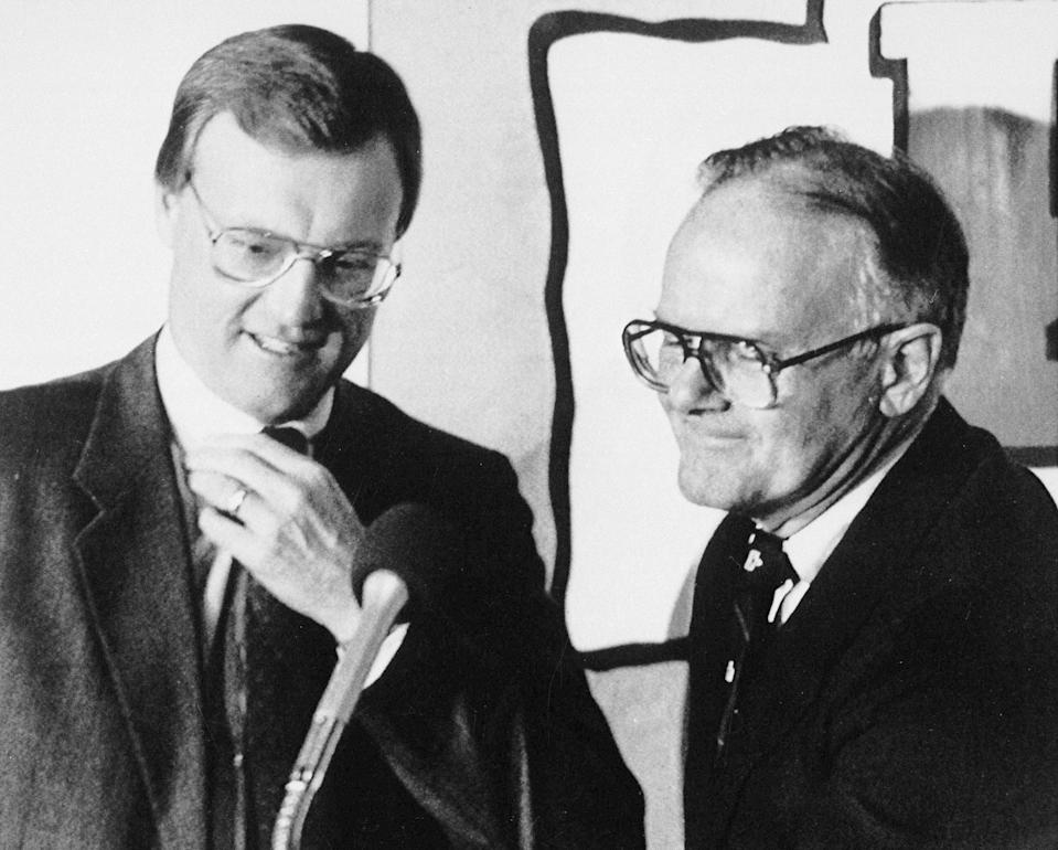 """FILE - Kansas City Chiefs owner Lamar Hunt, right, introduces new head coach Marty Schottenheimer at a press conference in Kansas City, Mo., in this Jan. 24, 1989, file photo. Schottenheimer, who won 200 regular-season games with four NFL teams thanks to his """"Martyball"""" brand of smash-mouth football but regularly fell short in the playoffs, has died. He was 77. Schottenheimer died Monday night, Feb. 8, 2021, at a hospice in Charlotte, North Carolina, his family said through Bob Moore, former Kansas City Chiefs publicist. (AP Photo/Cliff Schiappa)"""