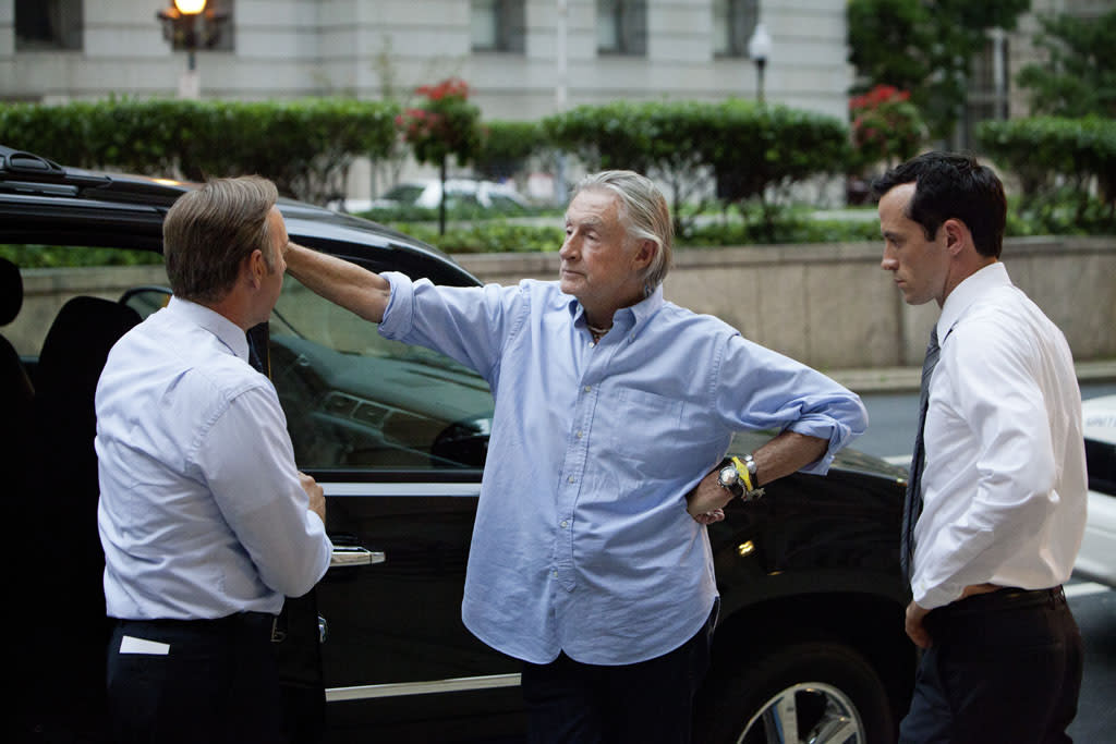 "Kevin Spacey, director Joel Schumacher and actor Nathan Darrow on the set of Netflix's ""House of Cards."""