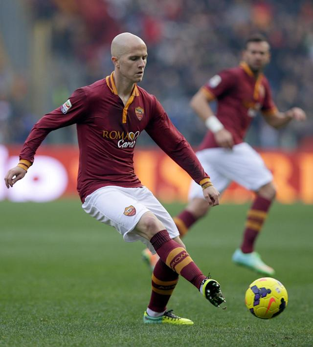 In this Dec. 22, 2013, photo, AS Roma's Michael Bradley controls the ball during a Serie A soccer match against Catania in Rome. Roma coach Rudi Garcia says American midfielder Bradley is on the verge of joining Toronto FC. Italian media report Roma has accepted an offer of 7 million euros ($9.5 million) for Bradley from the Major League Soccer club. (AP Photo/Gregorio Borgia)