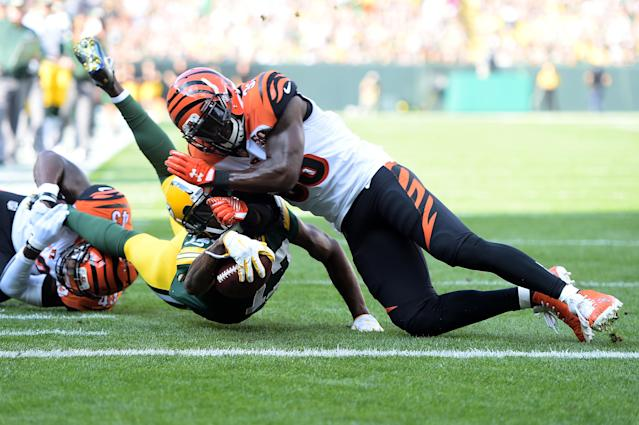 <p>Davante Adams #17 of the Green Bay Packers is tackled by Shawn Williams #36 of the Cincinnati Bengals diving towards the end zone during the first quarter of their game at Lambeau Field on September 24, 2017 in Green Bay, Wisconsin. (Photo by Stacy Revere/Getty Images) </p>
