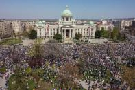People attend a protest in front of the Serbian parliament in Belgrade