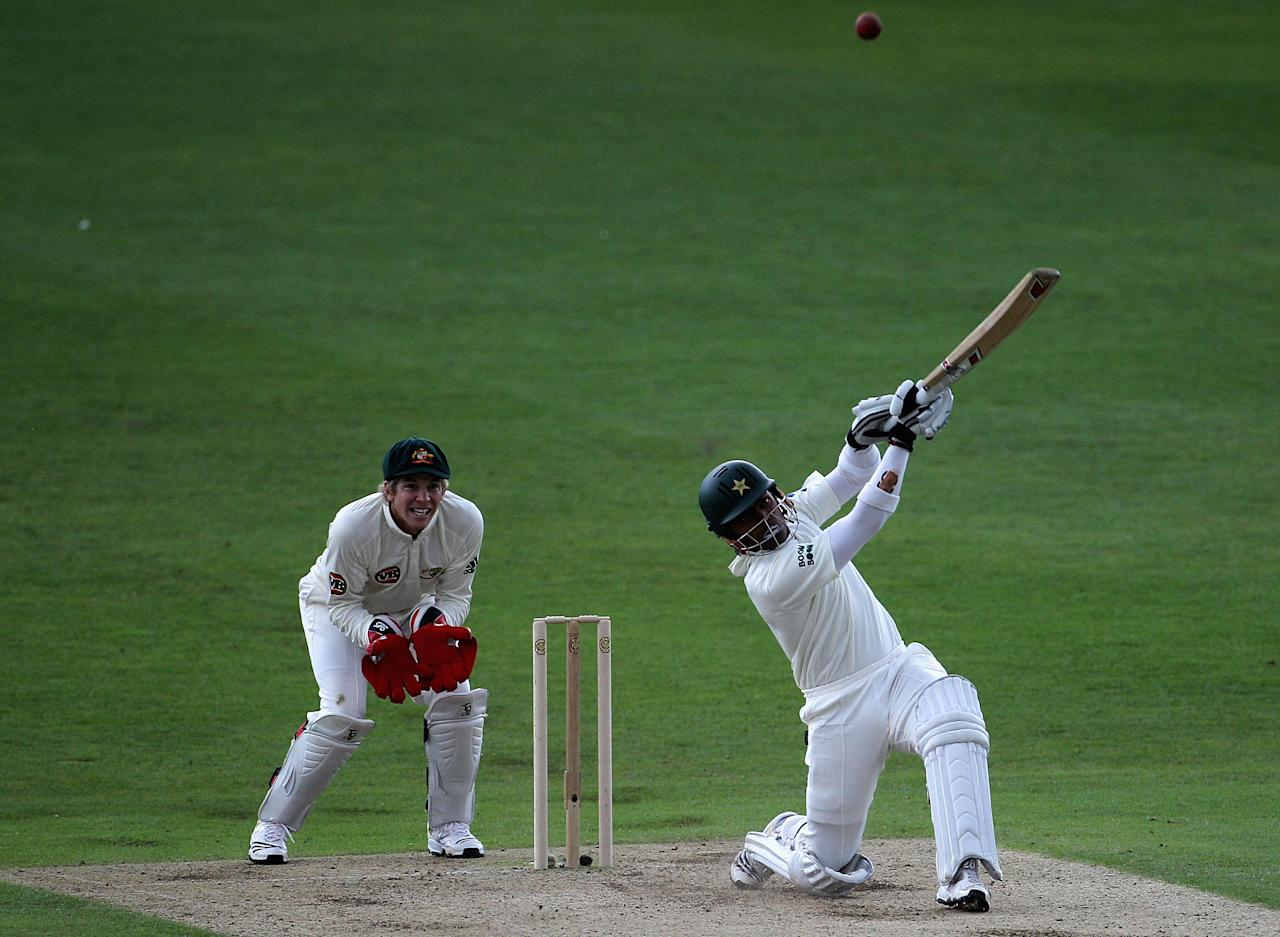 LEEDS, ENGLAND - JULY 21:  Umar Akmal of Pakistan hits a six with Tim Paine of Australia looking on during day one of the 2nd Test between Pakistan and Australia played at Headingley Carnegie Stadium on July 21, 2010 in Leeds, England.  (Photo by Hamish Blair/Getty Images)