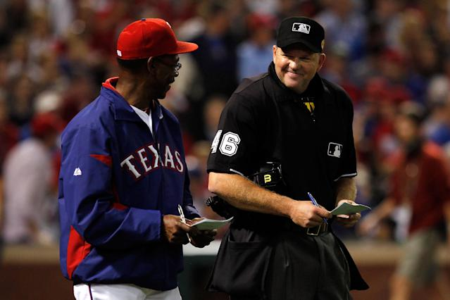 ARLINGTON, TX - OCTOBER 23: Manager Ron Washington talks with home plate umpire Ron Kulpa during Game Four of the MLB World Series against the St. Louis Cardinals at Rangers Ballpark in Arlington on October 23, 2011 in Arlington, Texas. (Photo by Tom Pennington/Getty Images)
