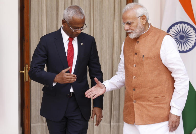Indian Prime Minister Narendra Modi, right, prepares to shake hands with Maldives President Ibrahim Mohamed Solih before their meeting in New Delhi, India, Monday, Dec. 17, 2018. Solih is on a three-day visit to India. (AP Photo/Manish Swarup)