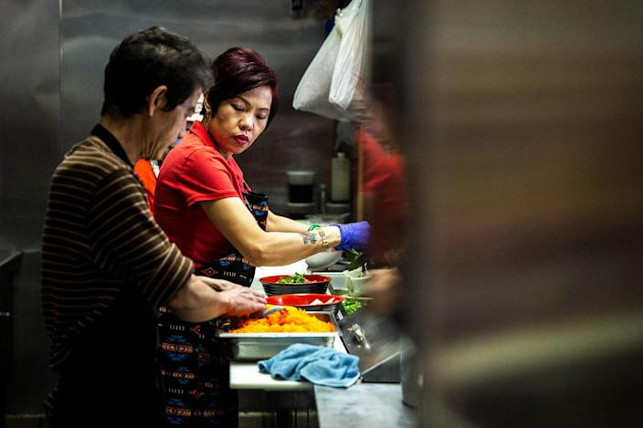 Brenda Tran, owner of the Vietnam Cafe, works in the kitchen with her staff to prep and prepare to-go orders on Sunday, May 3, 2020, in the Merle Hay Mall food court in Des Moines, Iowa.