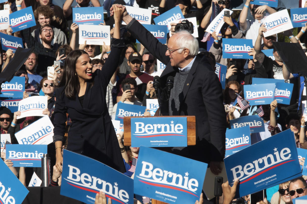 Sen. Bernie Sanders is introduced by Rep. Alexandria Ocasio-Cortez during a campaign rally in Queens, N.Y., in October. (Photo: Mary Altaffer/AP)