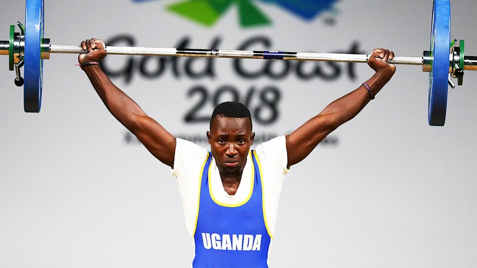 Julius Ssekitoleko (pictured) lifting during the Commonwealth Games.