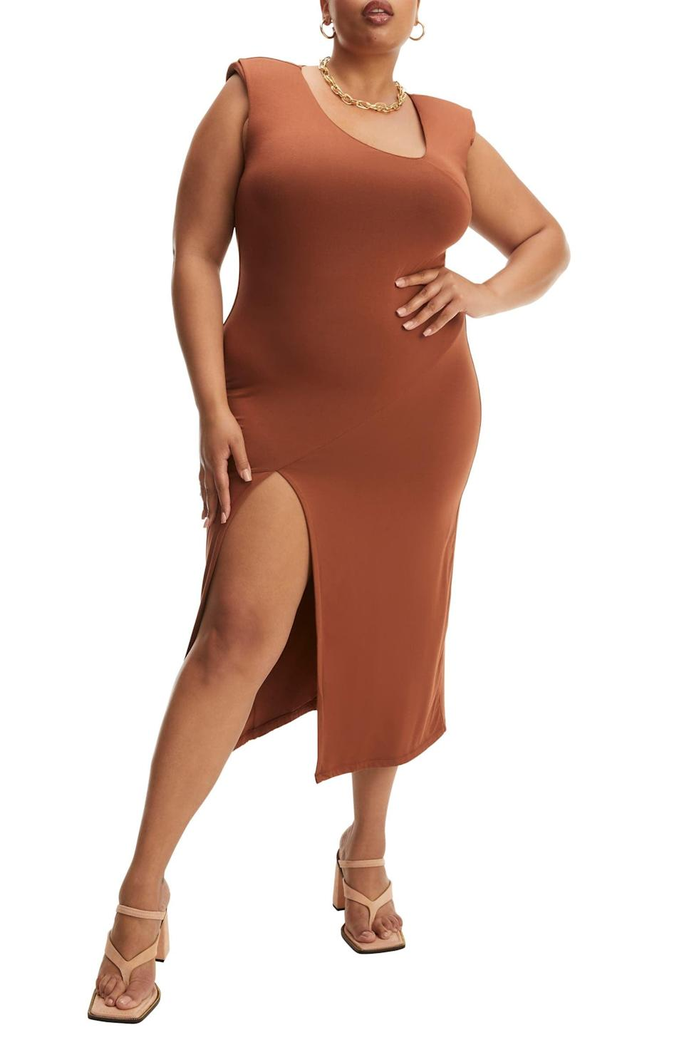 <p>You'll look chic and feel comfortably sexy in this statement <span>Good American Asymmetric Neck Midi Dress</span> ($139). Complete the look with a round necklace and some thong sandals.</p>