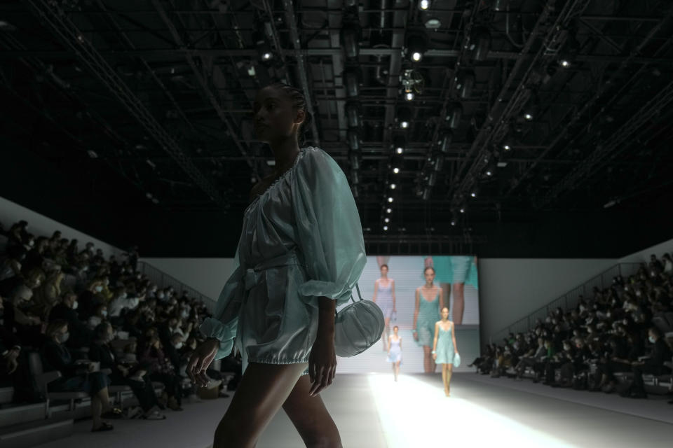 A model wears a creation for the Emporio Armani Spring Summer 2022 collection during Milan Fashion Week, in Milan, Italy, Thursday, Sept. 23, 2021. (AP Photo/Luca Bruno)