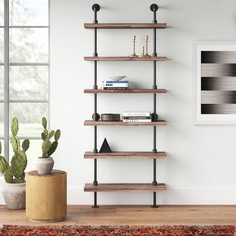 "Ideal for book lovers, writers, and those looking to feel a bit homier. <br><br><strong><em><a href=""https://www.allmodern.com/furniture/sb0/bookcases-bookshelves-c366836.html"" rel=""nofollow noopener"" target=""_blank"" data-ylk=""slk:Shop AllModern"" class=""link rapid-noclick-resp"">Shop AllModern</a></em></strong> <br><br><strong>AllModern</strong> Tacoma Iron Pipe Wall Mount Ladder Bookcase, $, available at <a href=""https://go.skimresources.com/?id=30283X879131&url=https%3A%2F%2Fwww.allmodern.com%2Ffurniture%2Fpdp%2Ftacoma-iron-pipe-wall-mount-ladder-bookcase-a000763026.html%3F"" rel=""nofollow noopener"" target=""_blank"" data-ylk=""slk:AllModern"" class=""link rapid-noclick-resp"">AllModern</a>"