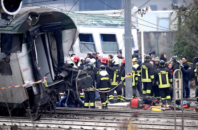 <p>Fire fighters and police officers stand near derailed trains in Pioltello, on the outskirts of Milan, Italy, Jan. 25, 2018. (Photo: Stringer/Reuters) </p>