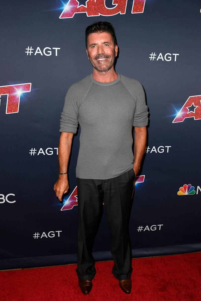 Simon Cowell broke his back Saturday in a fall from an electric bike. (Photo: Frazer Harrison via Getty Images)