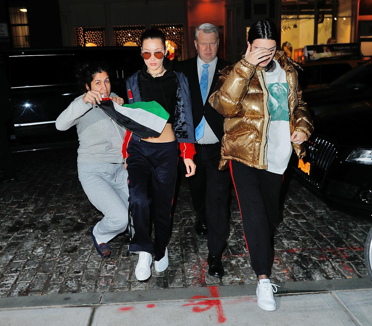 Scary moment as a crazed fan drapes the Palestinian flag across Bella Hadid and Kendall Jenner upon arrival at Gigi's apartment in New York.� The fan was arrested by police moments later<P>Pictured: Bella Hadid, Kendall Jenner<B>Ref: SPL1424695  180117  </B><BR/>Picture by: Jackson Lee / Splash News<BR/></P><P><B>Splash News and Pictures</B><BR/>Los Angeles:310-821-2666<BR/>New York:212-619-2666<BR/>London:870-934-2666<BR/>photodesk@splashnews.com<BR/></P>