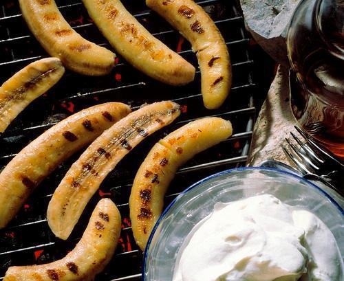 bananas on the grill with whipped cream