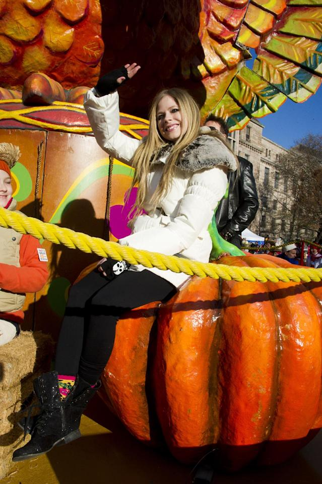 Avril Lavigne rides a float in the Macy's Thanksgiving Day Parade in New York, Thursday, Nov. 24, 2011. A jetpack-wearing monkey and a freakish creation from filmmaker Tim Burton are two of the big new balloons that will make their inaugural appearances in front of millions of people at this year's parade.(AP Photo/Charles Sykes)