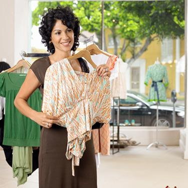 Female-customer-holding-up-blouse-in-boutique_web