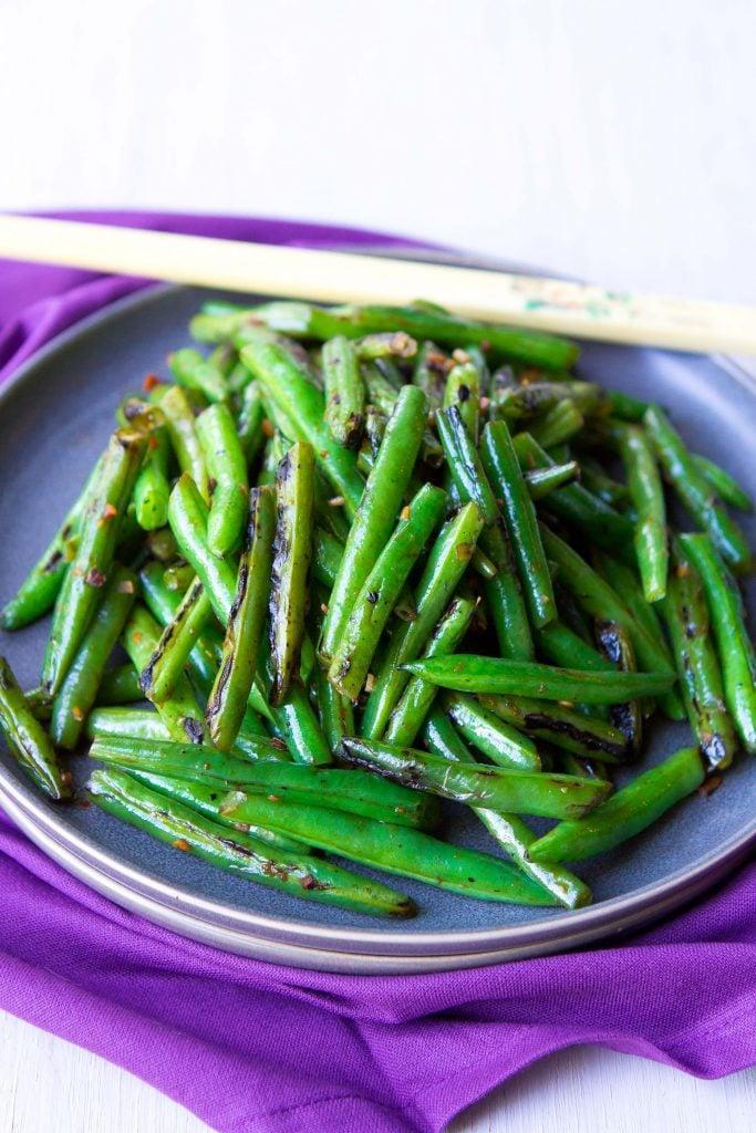 "<p>Your family probably won't be surprised by the green beans on your holiday dinner table - that's until their first bite makes them sweat a little.</p> <p><strong>Get the recipe: </strong><a href=""https://www.cookincanuck.com/spicy-green-bean-stir-fry-recipe/"" class=""link rapid-noclick-resp"" rel=""nofollow noopener"" target=""_blank"" data-ylk=""slk:spicy green bean stir fry"">spicy green bean stir fry</a></p> <p>Click <a href=""https://www.popsugar.com/smart-living/Health-Wellness-Tips-46521311"" class=""link rapid-noclick-resp"" rel=""nofollow noopener"" target=""_blank"" data-ylk=""slk:here for more health and wellness stories, tips, and news"">here for more health and wellness stories, tips, and news</a>.</p>"