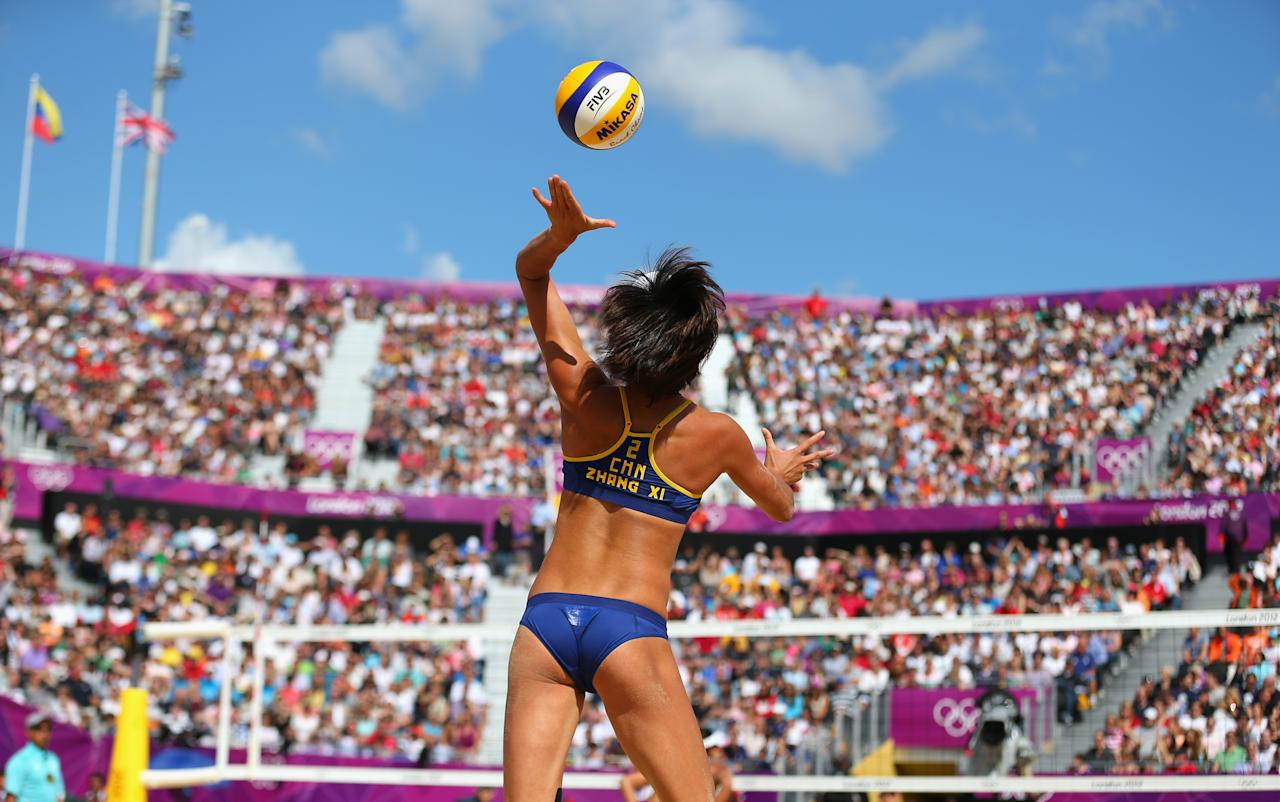 LONDON, ENGLAND - JULY 30:  Xi Zhang of China serves during her Women's Beach Volleyball Preliminary match with Chen Xue of China against Simone Kuhn and Nadine Zumkehr of Switzerland on Day 3 of the London 2012 Olympic Games at Horse Guards Parade on July 30, 2012 in London, England.  (Photo by Ryan Pierse/Getty Images)