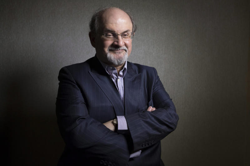 """FILE - This Sept. 8, 2012 file photo shows author Salman Rushdie posing during the 2012 Toronto International Film Festival in Toronto. Rushdie is promoting the film adaptation of his breakthrough novel, """"Midnight's Children,"""" winner of the Booker Prize in 1981 and one of the most highly praised works of fiction of its time. (AP Photo/The Canadian Presss, Chris Young, file)"""