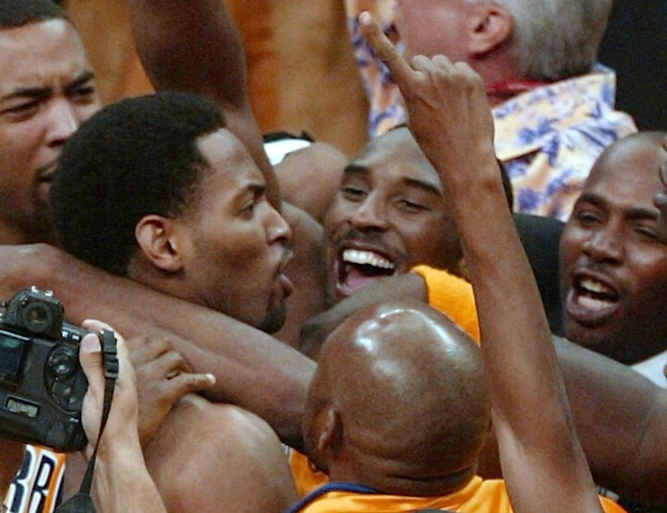 Robert Horry is mobbed by Lakers teammates, including Kobe Bryant, after his game-winner in the 2002 Western Conference finals. (Robert Sullivan/AFP via Getty Images)