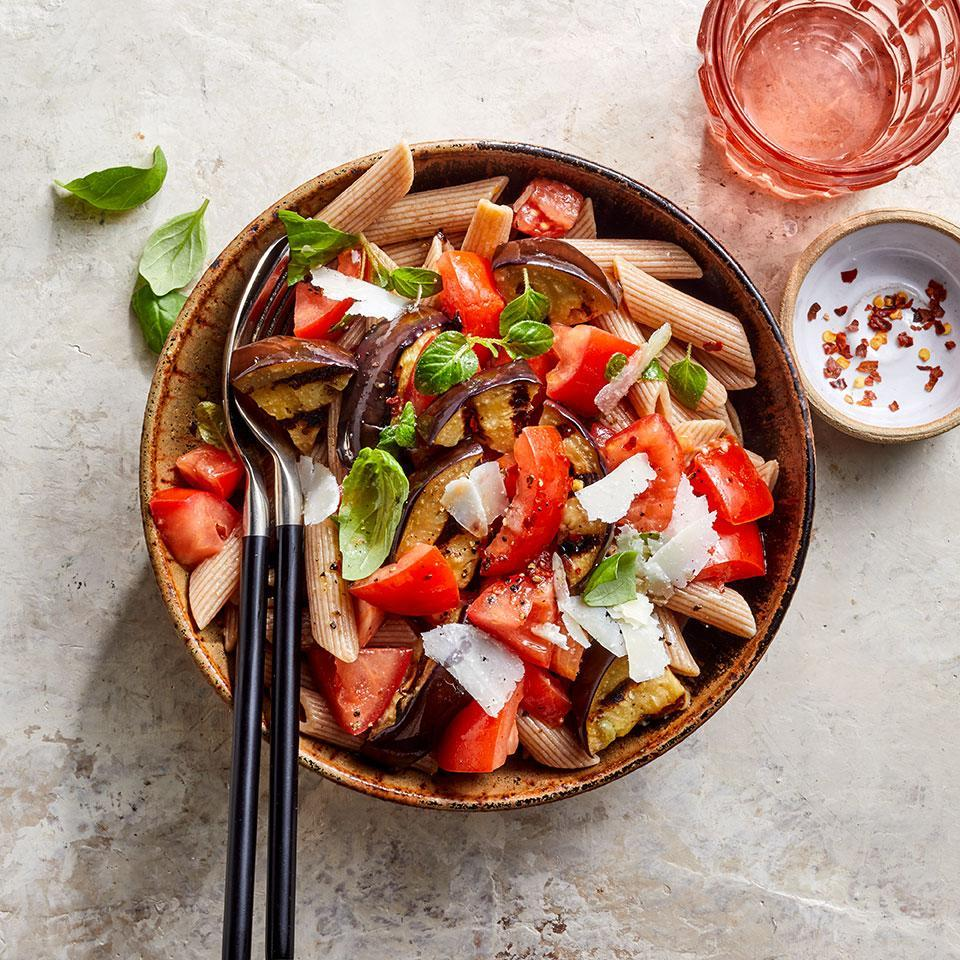 """<p>The combination of slightly smoky grilled eggplant and sweet tomatoes is delightful. The eggplant-tomato mixture served over whole-wheat pasta with fresh basil and a bit of salty cheese makes an easy, healthy weeknight dinner. <a href=""""http://www.eatingwell.com/recipe/274136/grilled-eggplant-tomato-pasta/"""" rel=""""nofollow noopener"""" target=""""_blank"""" data-ylk=""""slk:View recipe"""" class=""""link rapid-noclick-resp""""> View recipe </a></p>"""