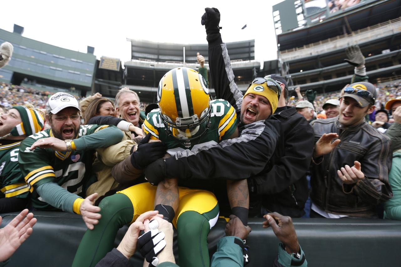 GREEN BAY, WI - DECEMBER 2: James Jones #89 of the Green Bay Packers celebrates with fans after a 32-yard touchdown reception against the Minnesota Vikings during the first half of the game at Lambeau Field on December 2, 2012 in Green Bay, Wisconsin. (Photo by Joe Robbins/Getty Images)