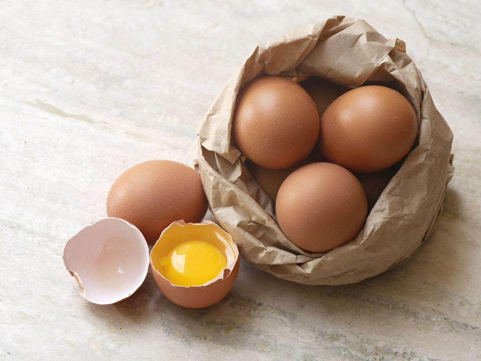 """<p>While <a href=""""https://www.prevention.com/food-nutrition/healthy-eating/a20508054/are-eggs-healthy/"""" rel=""""nofollow noopener"""" target=""""_blank"""" data-ylk=""""slk:eggs"""" class=""""link rapid-noclick-resp"""">eggs</a> have high cholesterol content, research shows that it doesn't affect your overall blood cholesterol the same way that saturated fats do. In fact, one <u><a href=""""https://www.tandfonline.com/doi/abs/10.1080/07315724.2016.1152928"""" rel=""""nofollow noopener"""" target=""""_blank"""" data-ylk=""""slk:meta-analysis"""" class=""""link rapid-noclick-resp"""">meta-analysis</a></u> published in the <em>Journal of the American College of Nutrition, </em>found that individuals with a high egg intake (about seven a week), had a 12 percent reduced risk of stroke compared to those who had a low egg intake (less than two a week). <br></p>"""