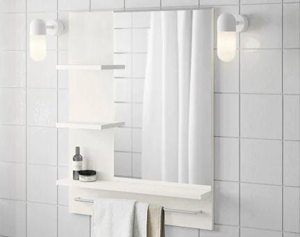 """Keep your counter clutter-free with this mirror that features plenty of shelving and a towel bar. <a href=""""https://fave.co/2ZxO780"""" target=""""_blank"""" rel=""""noopener noreferrer"""">Find it for $50 at IKEA.</a>"""