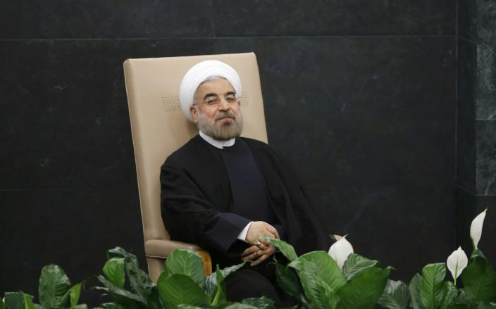 Iran's President Hassan Rouhani waits to address the 68th United Nations General Assembly at UN headquarters in New York, September 24, 2013 REUTERS/Ray Stubblebine (UNITED STATES - Tags: POLITICS)