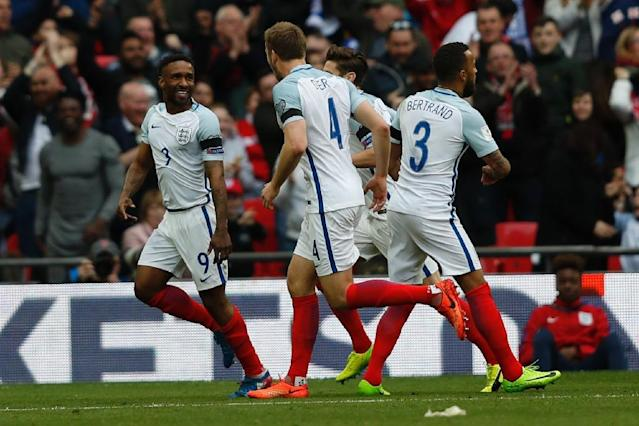 England's striker Jermain Defoe (L) celebrates with teammates after scoring against Lithuania at Wembley Stadium in London on March 26, 2017 (AFP Photo/Adrian DENNIS)