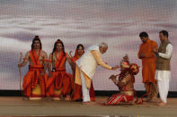 """FILE - In this Oct. 8, 2019, file photo, Indian Prime Minister Narendra Modi applies vermilion on the forehead of an artist dressed as Hindu monkey god Hanuman, watched by artists dressed as Rama, his brother Lakshman and wife Sita, at an event marking the end of Dussehra festival in New Delhi, India. Seeking comfort in the certainty of the past, Indians are devouring reruns of popular Hindu religious dramas as the country's public broadcaster has revived epic television shows like """"Ramayan,"""" the story of Lord Ram who was sent into exile for 14 years and rescued his kidnapped wife Sita from the demon Ravan, and """"Shri Krishna,"""" both highly revered mythological tales. On April 16, 2020, the show had a record 77 million viewers, India's public broadcaster Prasar Bharati tweeted. Prime Minister Narendra Modi has often invoked Hindu scriptures in his speeches during the lockdown, asking people to do their duty and follow social distancing rules to win the battle against COVID-19. (AP Photo/Manish Swarup, File)"""