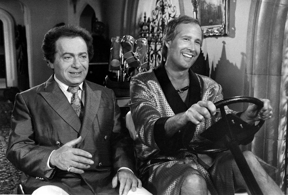 """Actor Jackie Mason and Chevy Chase on set of the movie """" Caddyshack II """" circa 1988."""