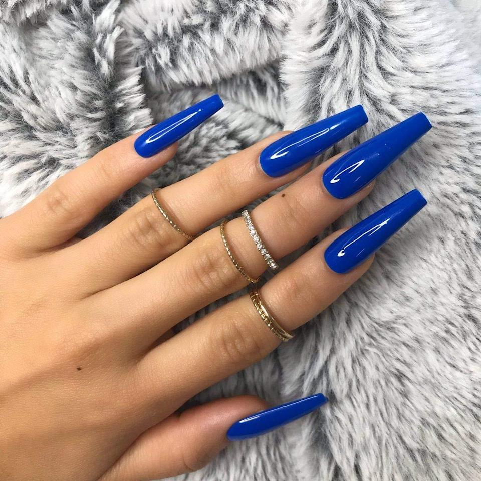 "<p>As far as monochromatic sets with major length go, the Allkem Beauty Extra Long Press-Ons simply <em>nail</em> it. Choose from bright reds, yellows, and blues in glossy finishes and either stiletto or coffin styles. One reviewer says she always receives compliments on ""the shape and vibrancy of these nails."" Each 20-piece set comes in a range of 10 different sizes to ensure the perfect fit for each finger. Just be sure to pick up a bottle of strong nail glue since this set doesn't come with any.</p> <p><strong>$10 to $18</strong> (<a href=""https://www.amazon.com/Stiletto-20pcs-cover-false-nails/dp/B088C3N1PW?th=1"" rel=""nofollow noopener"" target=""_blank"" data-ylk=""slk:Shop Now"" class=""link rapid-noclick-resp"">Shop Now</a>)</p>"