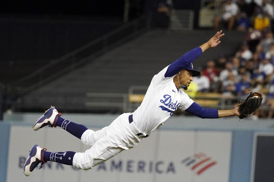 Dodgers player making a diving catch