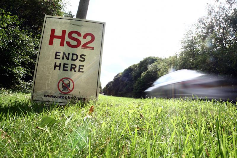 Stop the HS2 signs in the village of Wendover, Buckinghamshire as the local residents oppose the new rail link (Picture: PA)
