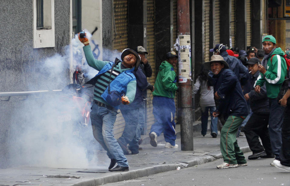 <p> A demonstrator returns a tear gas canister fired by police during a protest by striking miners in La Paz, Bolivia, Thursday, May 16, 2013. Workers from the workers union Central Obrera Boliviana (COB) began an indefinite strike on May 6 to demand the government of President Evo Morales improve the pension law. (AP Photo/Juan Karita)</p>