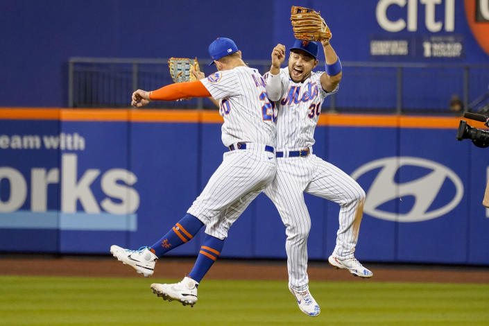 New York Mets' Michael Conforto (30) and Pete Alonso celebrate after defeating the Atlanta Braves during their baseball game, Wednesday, July 28, 2021, in New York. The Mets won 2-1. (AP Photo/Mary Altaffer)