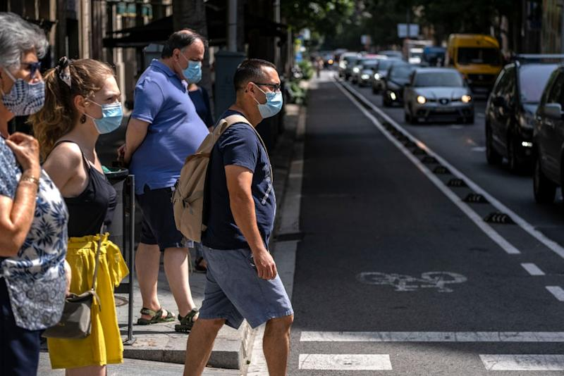 BARCELONA, CATALONIA, SPAIN - 2020/07/09: People wearing face masks as a precaution against the spread of the coronavirus during the pandemic. Catalonia will fine whoever does not wear a sanitary mask in public space with 100 euros, as a measure due to the Covid-19 outbreak. (Photo by Paco Freire/SOPA Images/LightRocket via Getty Images)
