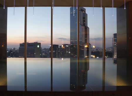 An indoor swimming pool is seen at the top of a luxury hotel in the Gangnam area of Seoul October 7, 2012. REUTERS/Lee Jae-Won/Files