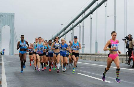 The elite women runners make their way across the Verrazano-Narrows Bridge during the start of the New York City Marathon in New York, U.S., November 5, 2017. REUTERS/Lucas Jackson