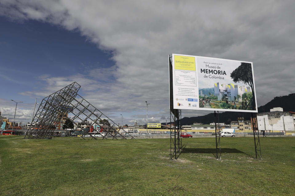 A sign announces the spot where Colombia's government plans to build a museum paying homage to the many victims of the country's long civil conflict in Bogota, Colombia, Tuesday, Dec. 17, 2019. The Museum of memory has become a very public feud because of the director overseeing it: longtime history professor Darío Acevedo, who has expressed a view of the conflict that critics say could excuse the state of much of its responsibility for the violence. (AP Photo/Fernando Vergara)