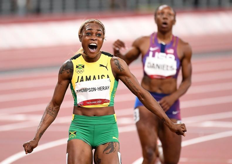 -TOKYO,JAPAN July 31, 2021: Jamaica's Elaine Thompson-Herah celebrates the gold medal in the 100m final at the 2020 Tokyo Olympics. (Wally Skalij /Los Angeles Times)