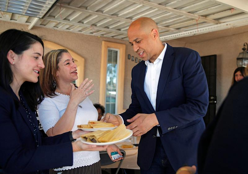 Sen. Cory Booker (D-N.J.) eating a tamale in Las Vegas on April 20.