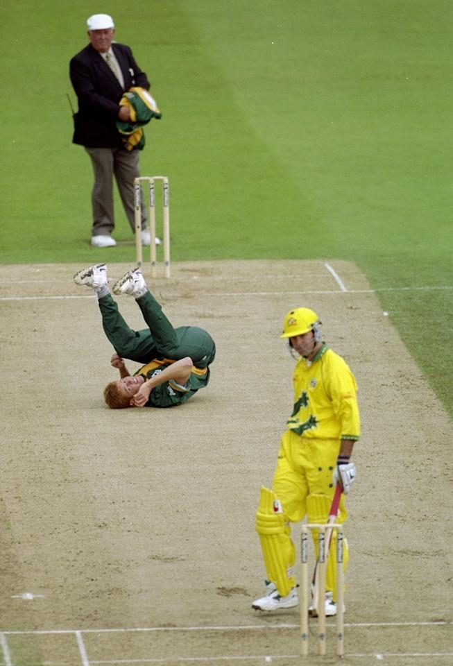 17 Jun 1999:  Shaun Pollock of South Africa takes a tumble after bowling to Rivky Ponting of Australia in the World Cup semi-final at Edgbaston in Birmingham, England. The match finished a tie as Australia went through after finishing higher in the SuperSix table. \ Mandatory Credit: Adrian Murrell /Allsport