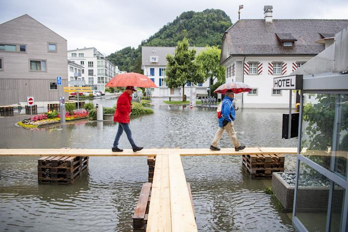 The flooded village square of Stansstad in the canton of Nidwalden on Lake Vierwaldstättersee in Stansstad, Switzerland, near Lake Lucerne on Thursday