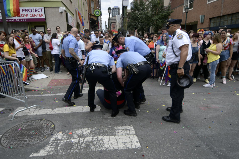 Police officers arrest a female, later identified as Ryan Segin, 18, after she attempted to lit a Blue Lives Matter flag in protest, ahead of the Pride Parade, in Philadelphia, PA, on June 10, 2018.  (Photo by Bastiaan Slabbers/NurPhoto via Getty Images)