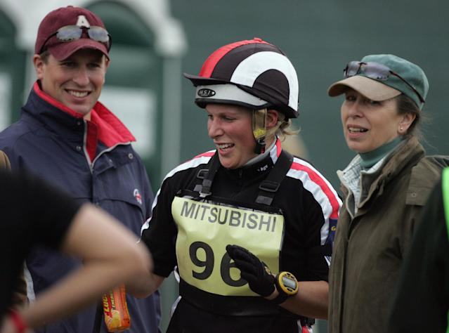 CHIPPING SODBURY, UNITED KINGDOM - MAY 03: Zara Phillips jokes with her mother Princess Anne (R) and her brother Peter Phillips after riding Ardfield Magic Star in the cross country during the Badminton Horse Trials on May 3 2008 in Badminton, England. Reigning world champion Zara Phillips is riding Glenbuck and Ardfield Magic Star at the world's largest three-day event as the British equestrian team look to finalise their 2008 Olympic squad. The event started with two days of dressage moving into cross country before finishing with showjumping tomorrow. (Photo by Matt Cardy/Getty Images)