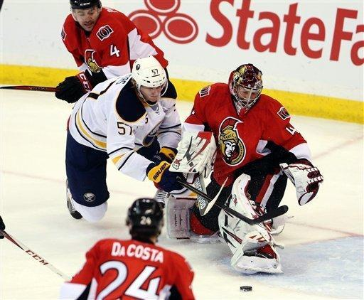 Buffalo Sabres' Tylers Myers (57) attempts to reach the puck as Ottawa Senators goaltender Craig Anderson (41) covers the net during the first period of their NHL hockey game, Tuesday, Feb. 12, 2013, in Ottawa, Ontario. (AP Photo/The Canadian Press, Fred Chartrand)